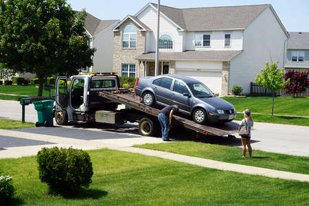 Car being put on a tow truck in Madison, TN.